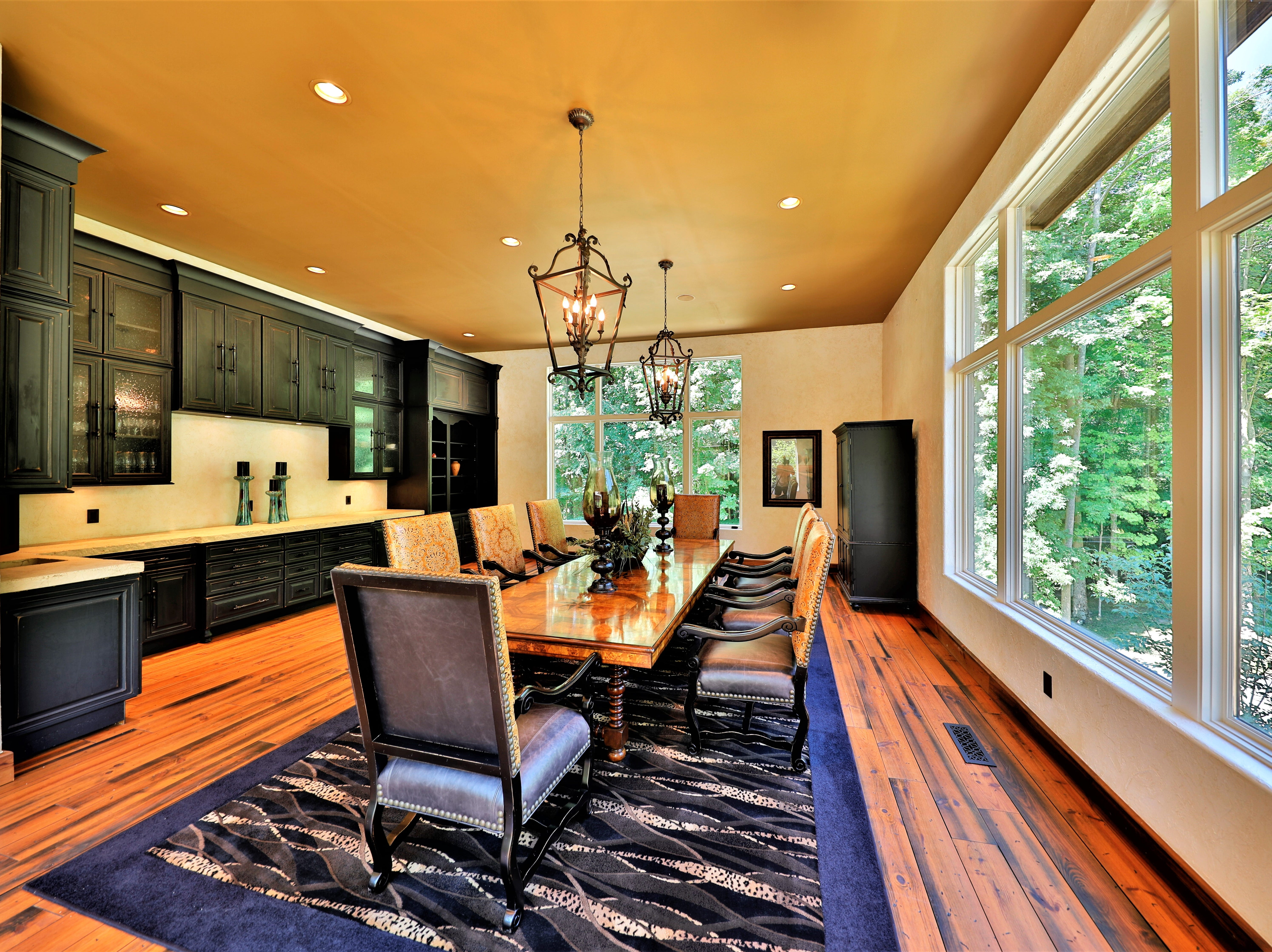 At the front of the house on the main floor is a conference room, complete with a wet bar.