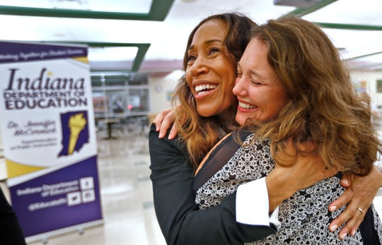 Kelly Bozoian, right, hugs McKenzie Center for Innovation & Technology pre-engineering teacher Tamara Markey after the ceremony where she was named the 2019 Indiana Department of Education Teacher of the Year, Thursday, Oct. 4, 2018.  Bozoian was Markey's mentor when Markey was a Woodrow Wilson Scholar.