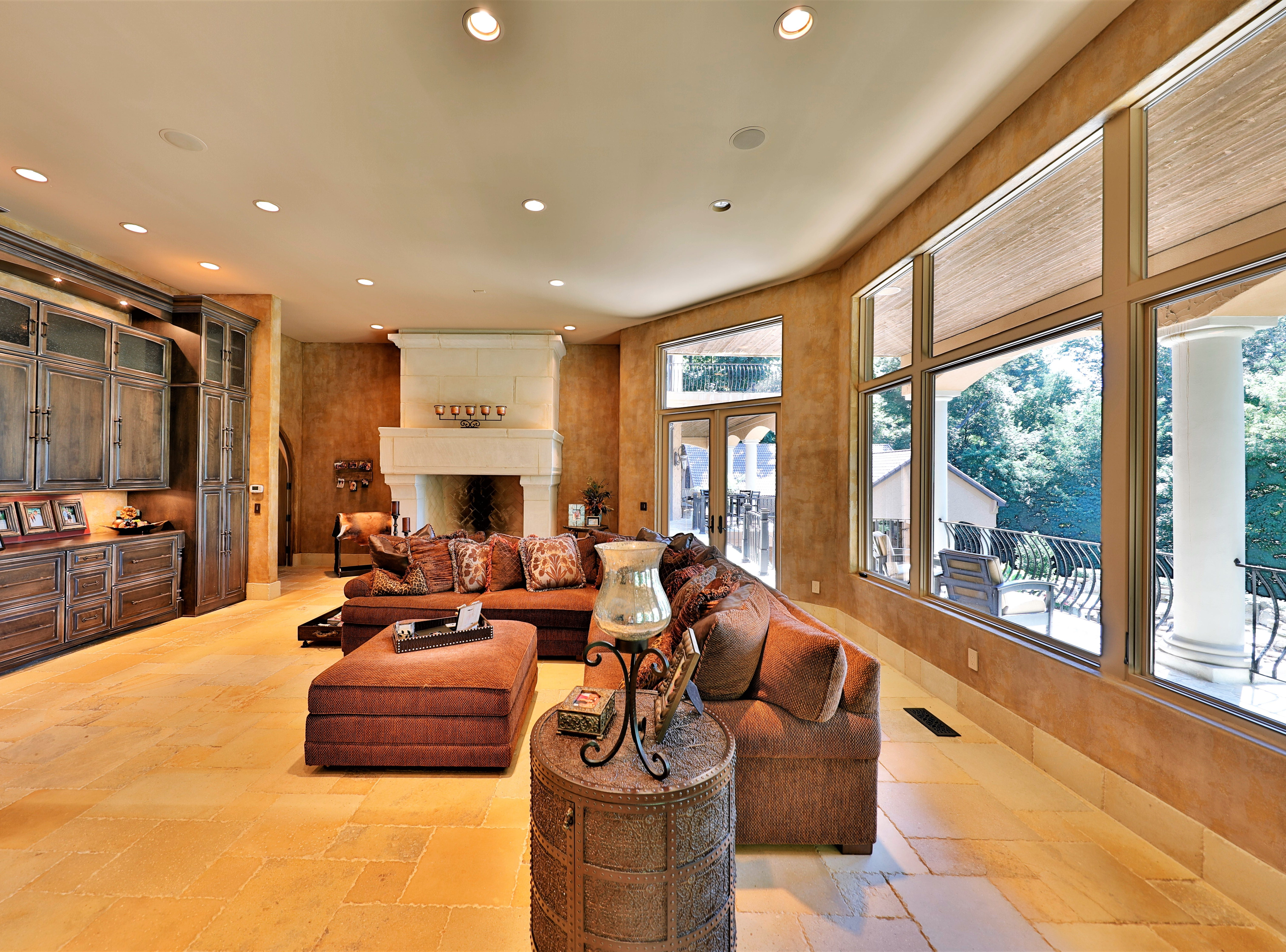 A family room on the main floor has another wood-burning fireplace and built-in storage.
