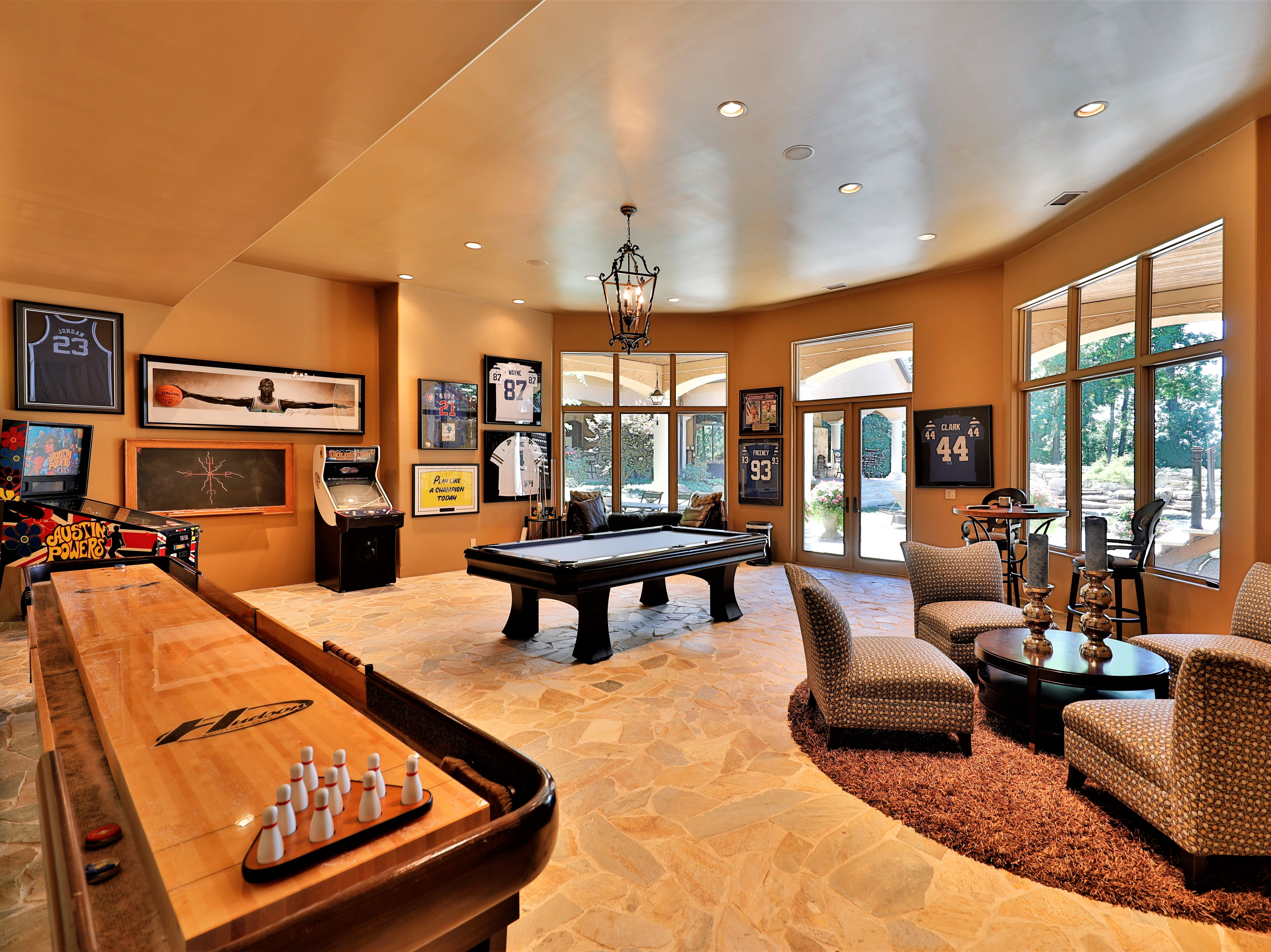 The walkout basement includes room for a pool table, shuffleboard table and, of course, a full kitchen.
