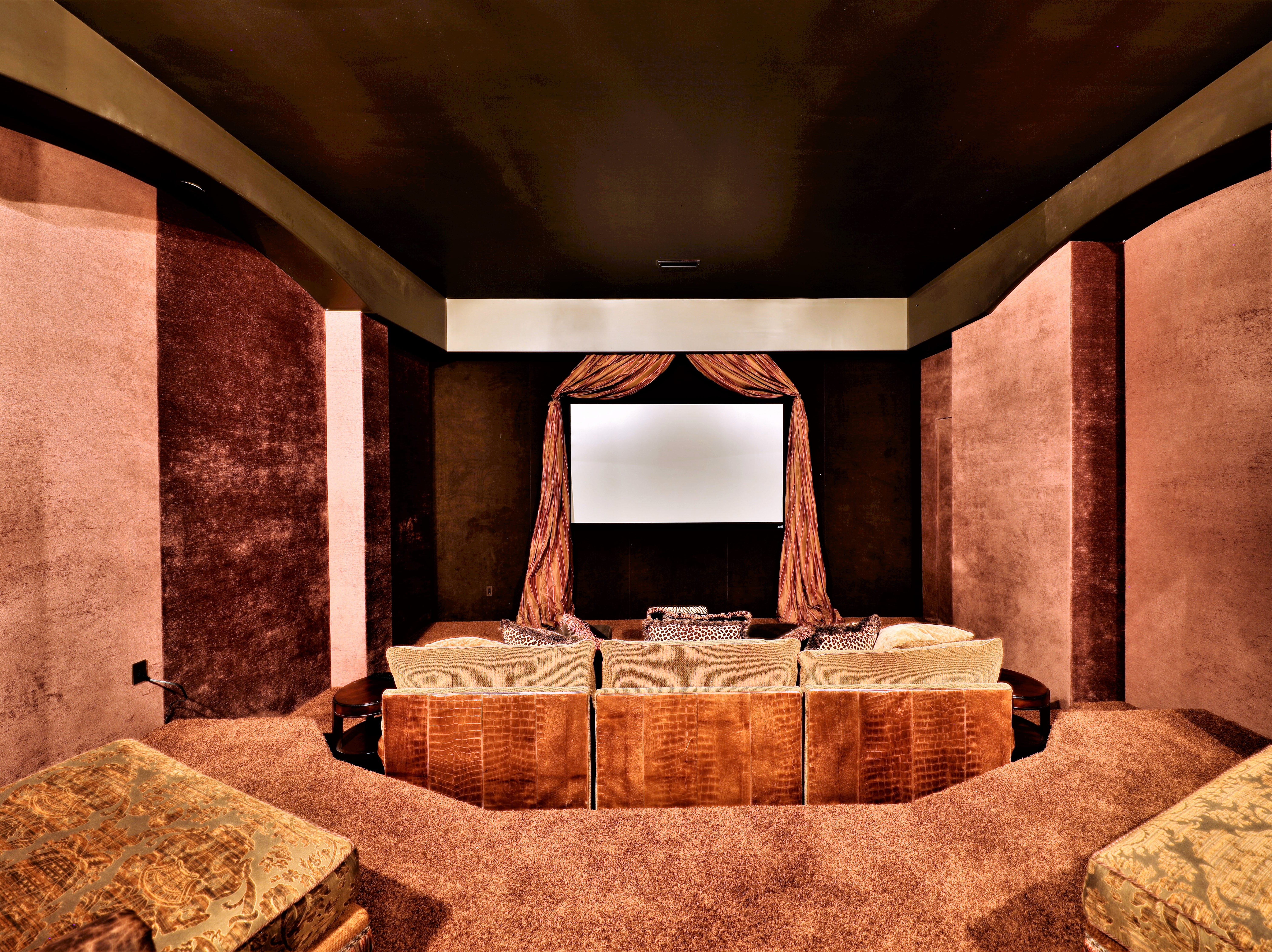 The basement also includes a home theater, with a stocked snack bar nearby.