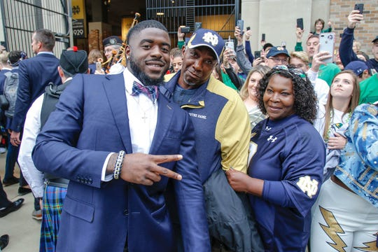 Dexter Williams (left) poses with his parents Leonard and Cheryl during Notre Dame's pregame walk prior to the Stanford game.