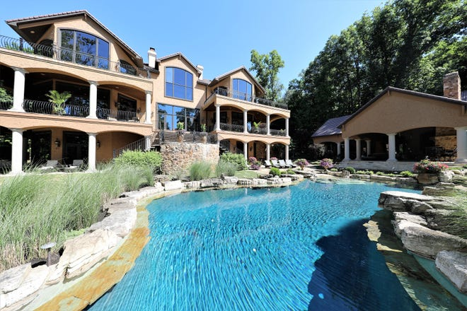 This 14,895 square-foot house in Fishers sits on seven acres on Geist Reservoir and is currently listed for nearly $4 million.