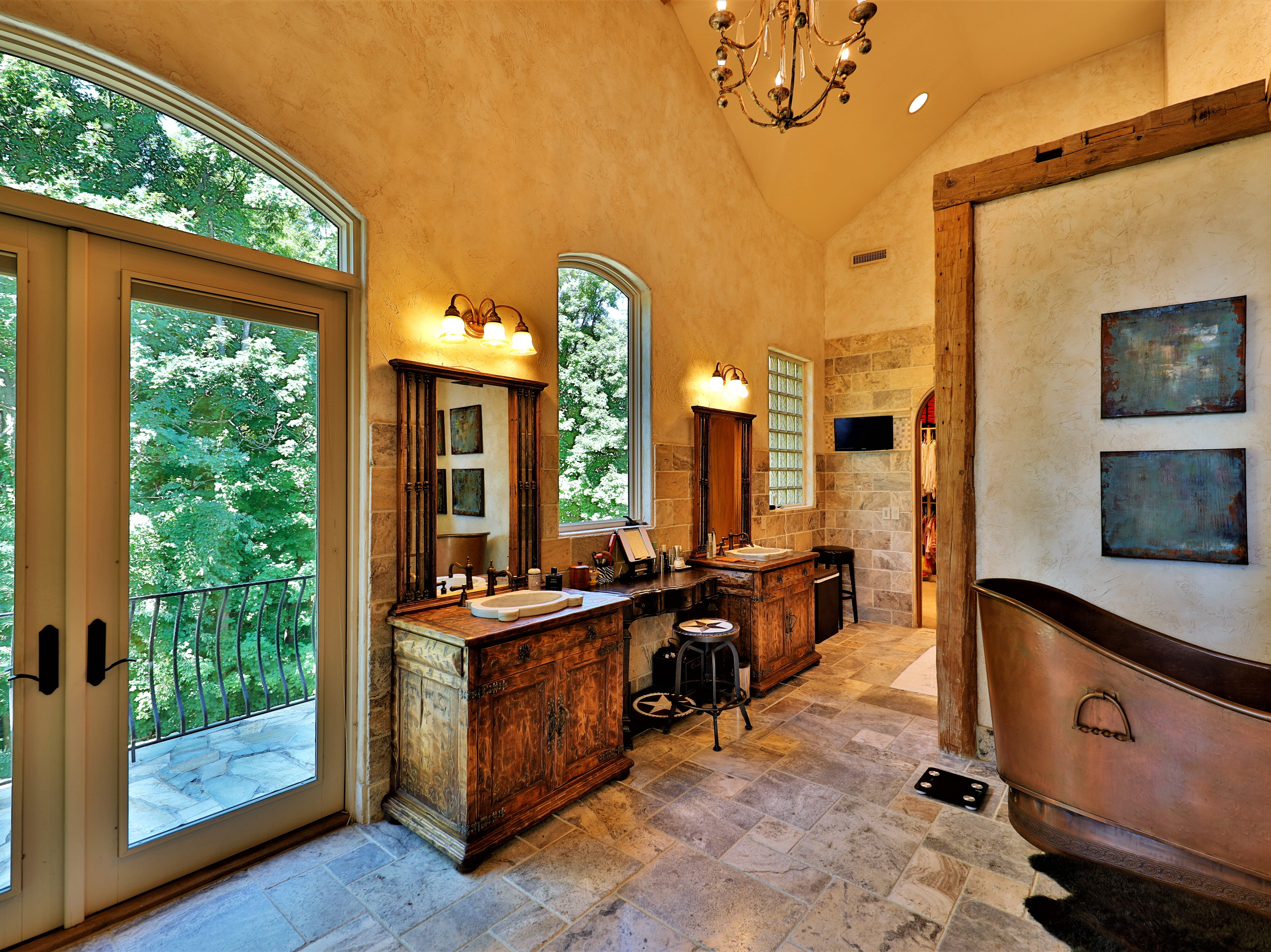 The master bathroom includes a freestanding bathtub and his-and-hers walk-in closets.