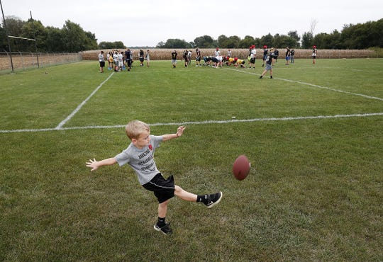 Tate Berry works on his punts as the Pioneer High School football players practice Tuesday, Sept. 2 2018, for their upcoming home conference game against Culver Community High School. Tate is the son of Panthers head football coach Adam Berry.