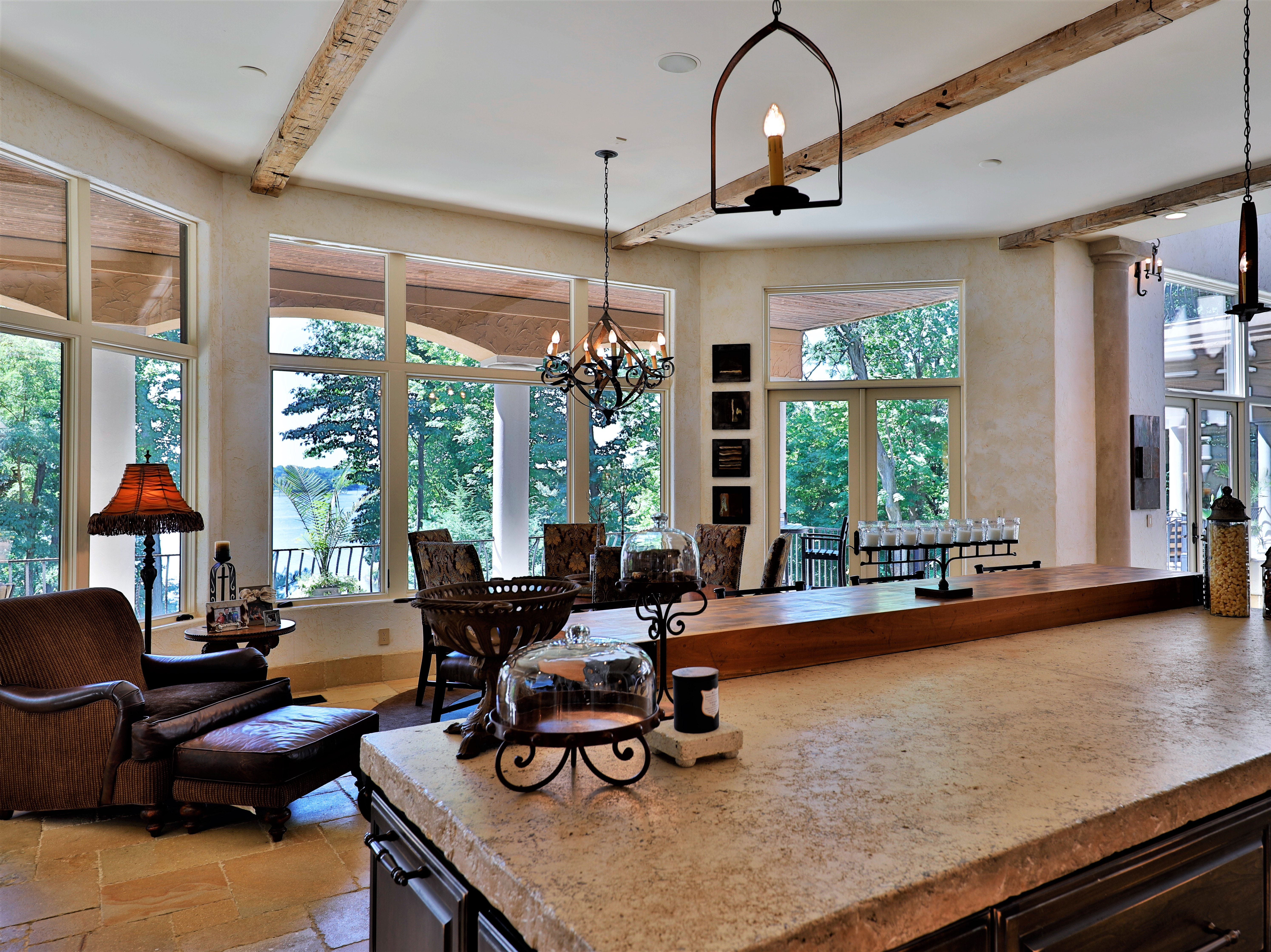 The main kitchen offers views of the reservoir and access to large, covered balcony above the walk-out basement.