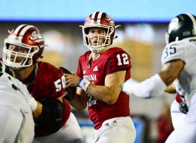 Indiana Hoosiers quarterback Peyton Ramsey (12) drops back to pass during the game against Michigan State at Memorial Stadium in Bloomington, Ind., on Saturday, Sept. 22, 2018.