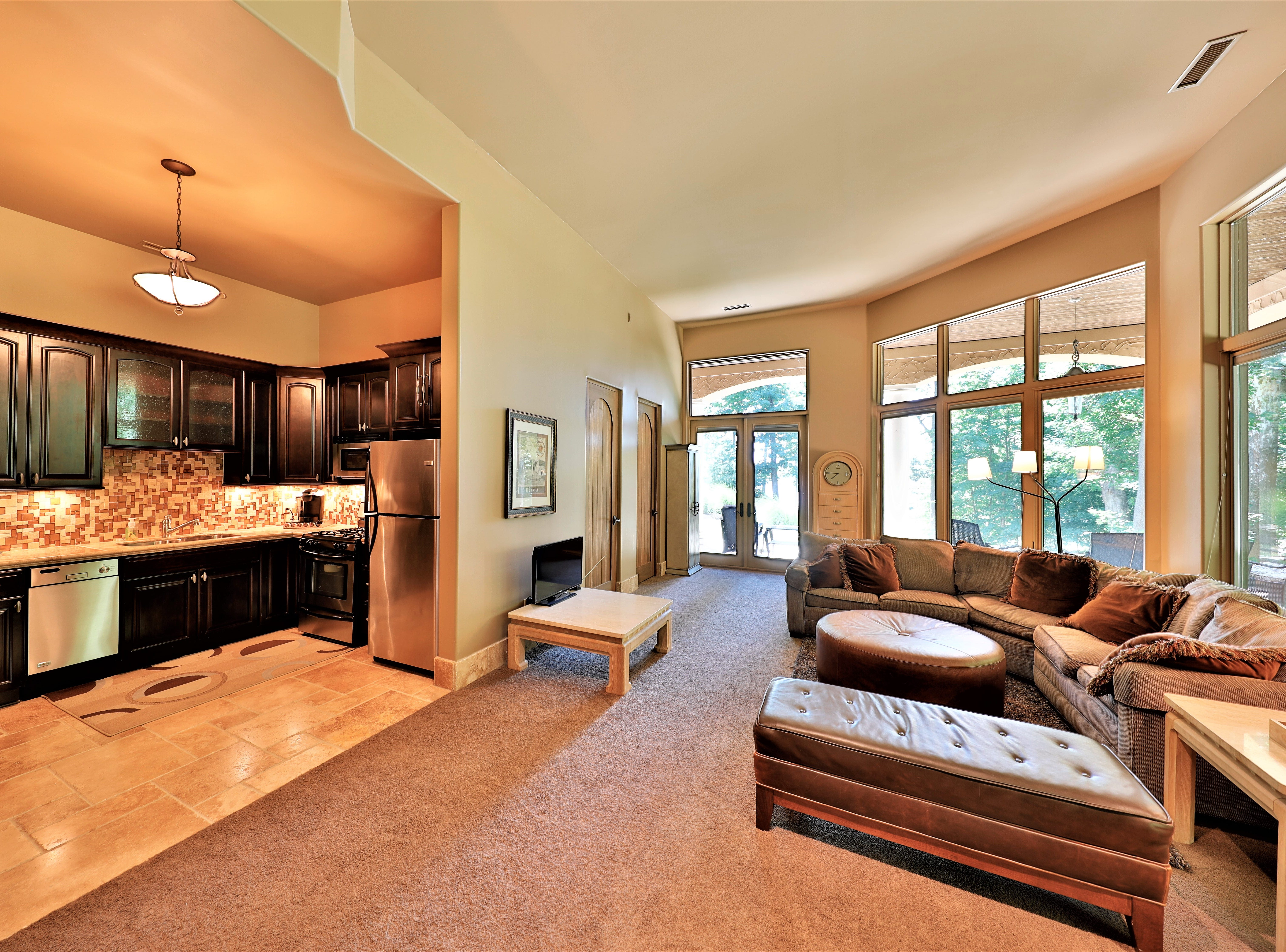 The basement suite includes a full kitchen, living area, bathroom and eating area.