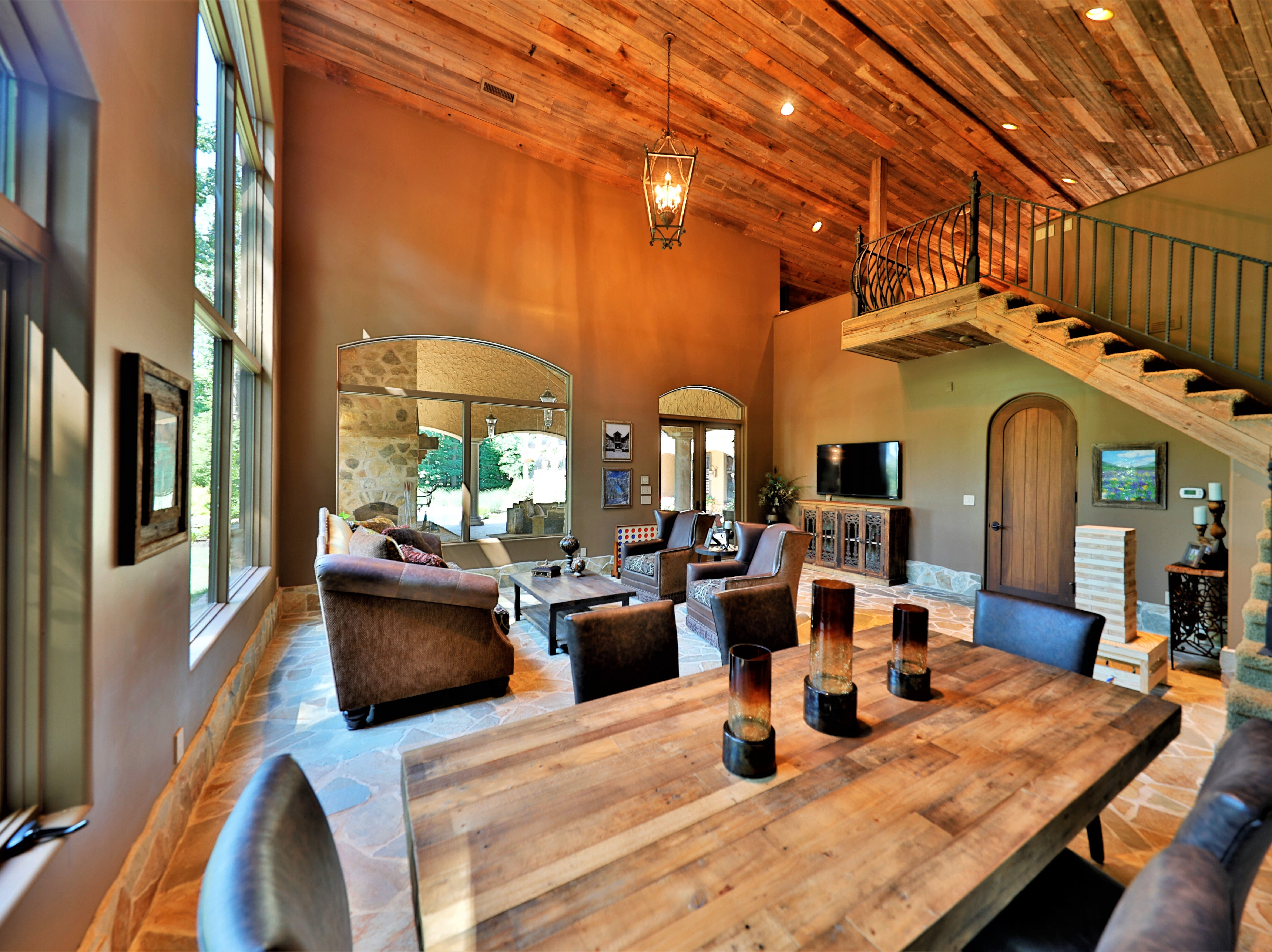 Inside the pool house is an indoor living area and dining room.
