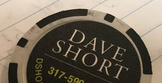 Dave Short's uses a black poker chip as a business card.