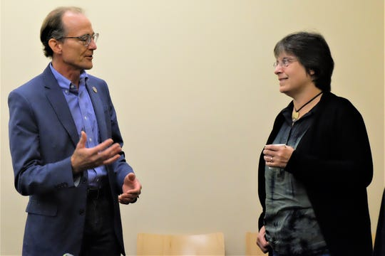 Stuart Valentine (left), president of SILT's board of directors, speaks with Suzan Erem (right), executive director and co-founder of SILT.