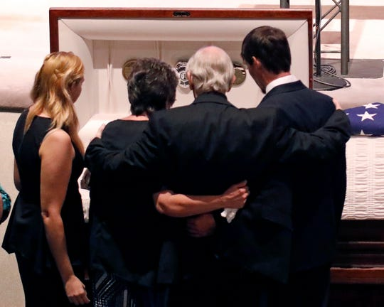 Family members pay their last respects to Brookhaven Police Corporal Zach Moak prior to funeral services Thursday, Oct. 4, 2018, at Easthaven Baptist Church in Brookhaven, Miss.