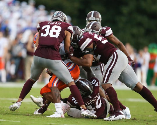 Mississippi State's Johnathan Abram (38) and Mississippi State's Kobe Jones (52) along with Mississippi State's Erroll Thompson (40) tackle a Florida runner. Mississippi State and Florida played in an SEC college football game on Saturday, September 29, 2018, in Starkville. Photo by Keith Warren/Madatory Photo Credit