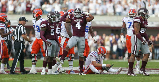 Mississippi State's Gerri Green (4) celebrates after sacking Florida's Feleipe Franks (13). Mississippi State and Florida played in an SEC college football game on Saturday, September 29, 2018, in Starkville. Photo by Keith Warren/Madatory Photo Credit