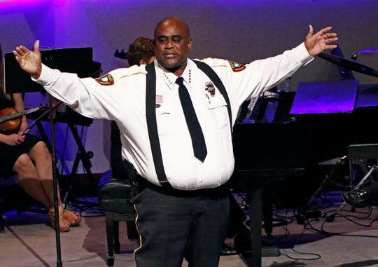 """Brookhaven Police Chief Kenneth Collins calls on all lawmen and women to stand and be acknowledged as """"family""""during funeral services Thursday, Oct. 4, 2018, for Brookhaven Police Corporal Zach Moak at Easthaven Baptist Church in Brookhaven, Miss."""