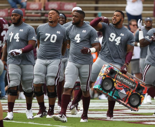 Mississippi State's Jeffery Simmons (94), Mississippi State's Gerri Green (4), Mississippi State's Tommy Champion (70) and Mississippi State's Elgton Jenkins (74) loosen up to music before the game. Mississippi State and Florida played in an SEC college football game on Saturday, September 29, 2018, in Starkville. Photo by Keith Warren/Madatory Photo Credit