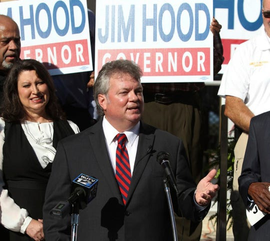 Mississippi Attorney General Jim Hood stands on the steps of the Chicksaw County Courthouse in Houston, Miss., with his family and supporters as he announces his candidacy for governor, Wednesday, Oct. 3, 2018. Hood is the only Democrat currently holding statewide office in Mississippi. (Adam Robison/The Northeast Mississippi Daily Journal via AP)