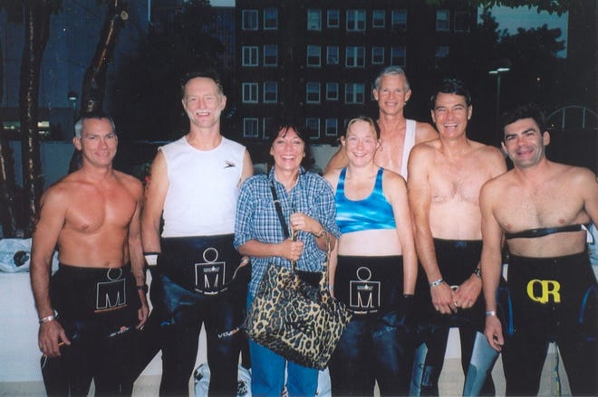 Six of these seven Tennesseans from Carroll and Weakley counties did the Ironman Wisconsin triathlon and the seventh (third from the left and not in a wetsuit) was the wife and mother of two of the six. Shown before dawn in September 2005, from left to right are Carroll County's Jimmy Crossett, Dr. Volker Winkler, Tina Winkler, Kirsten Winkler (now Sass) and Weakley County's Dr. Gwin Anderson, Roy Herron and Kelly McCreight. The six are believed to be the first Carroll and Weakley Countians to complete a 140.6 mile Ironman.