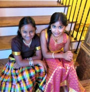 Young dancers Swara Kartik, 9, and Niyan Barath, 8, waited for their cue to perform a classical Indian dance.