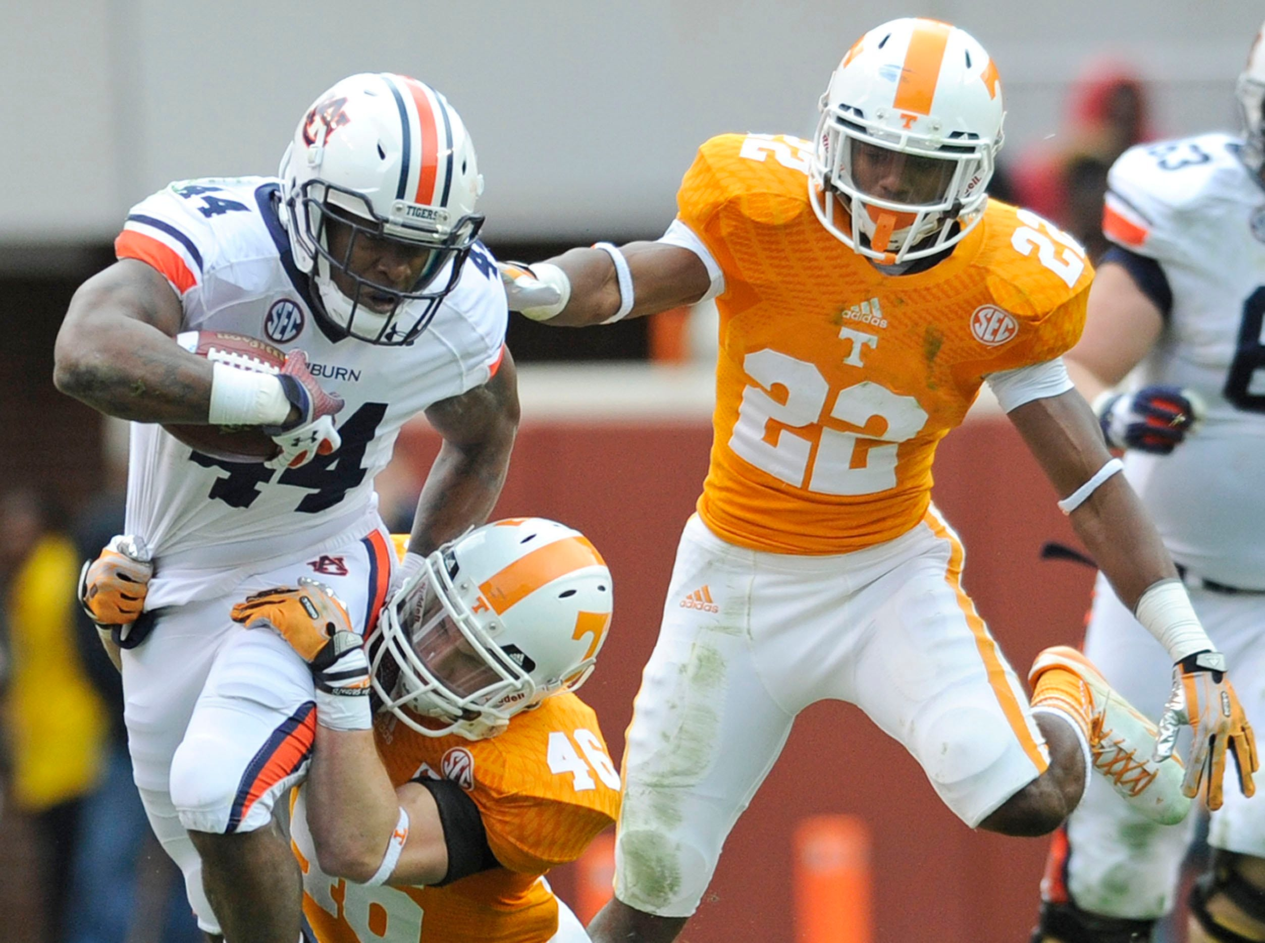 Auburn running back Cameron Artis-Payne (44) breaks tackles by Tennessee defensive back Max Arnold (46) and Tennessee defensive back Malik Foreman (22) during the second half at Neyland Stadium in Knoxville on Saturday, Nov. 9, 2013.