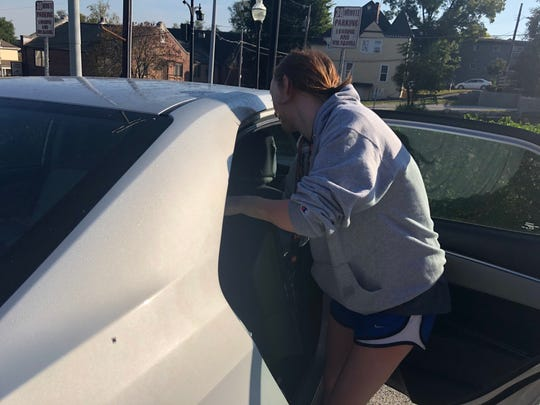 UT freshman Isabella Diaconescu loads her TV into her car on Oct. 4. Diaconescu said she had found another place on campus to live after mold was found in Laurel Hall.