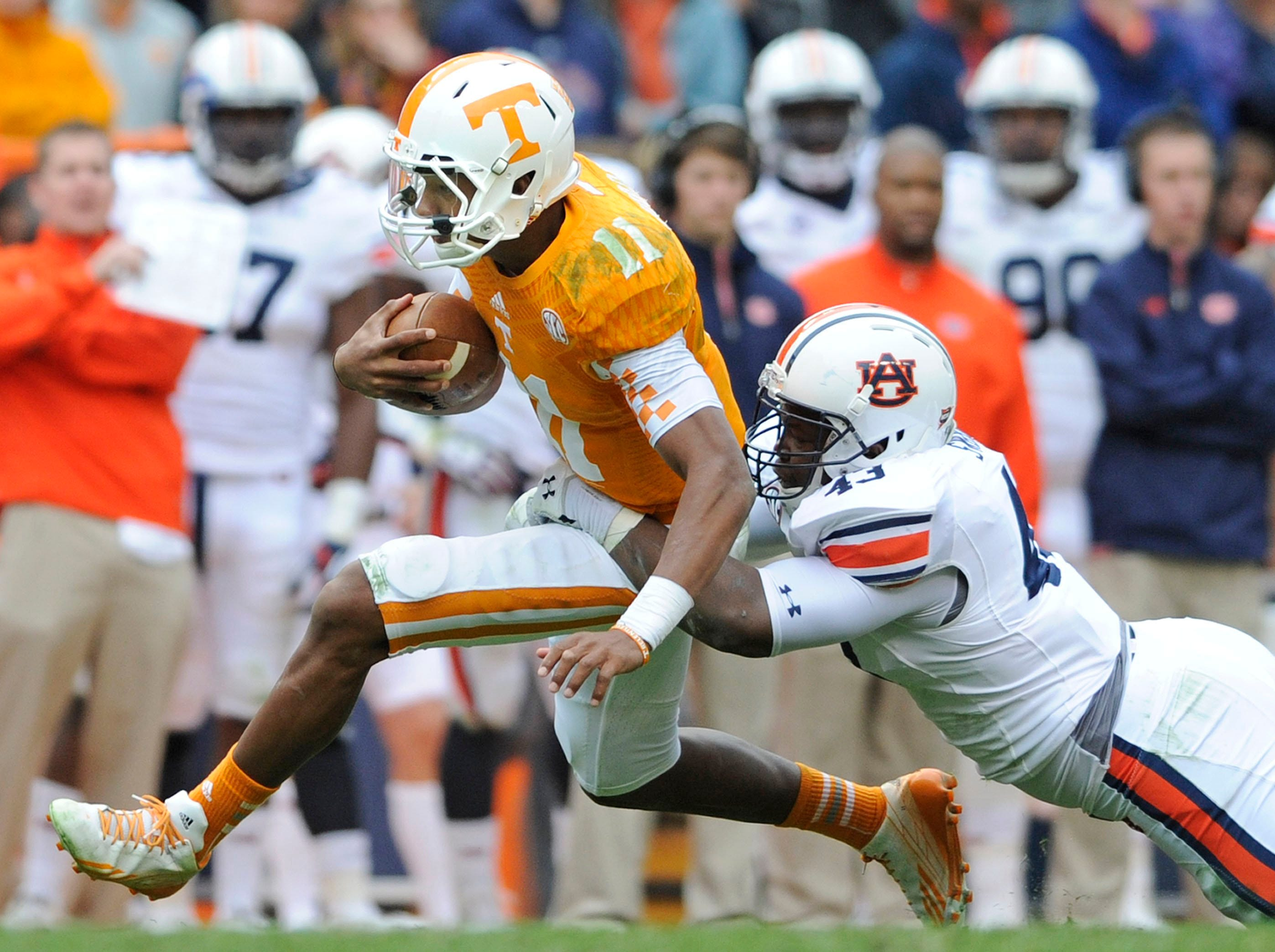 Tennessee quarterback Joshua Dobbs (11) is tackled by Auburn linebacker Anthony Swain (43) during the second half at Neyland Stadium in Knoxville on Saturday, Nov. 9, 2013.