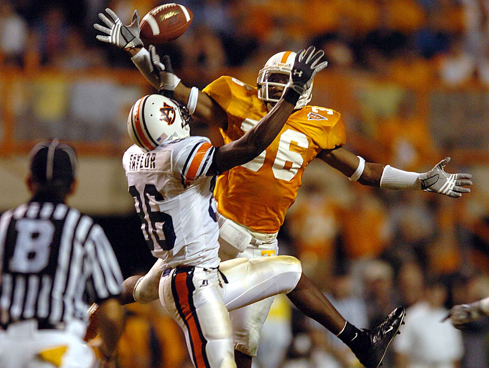 Tennessee's (36) Roshaun Fellows tips away a pass intended for Auburn's (86) Courtney Taylor during second half action Saturday night at Neyland Stadium in 2004. Auburn won the game 34-10.