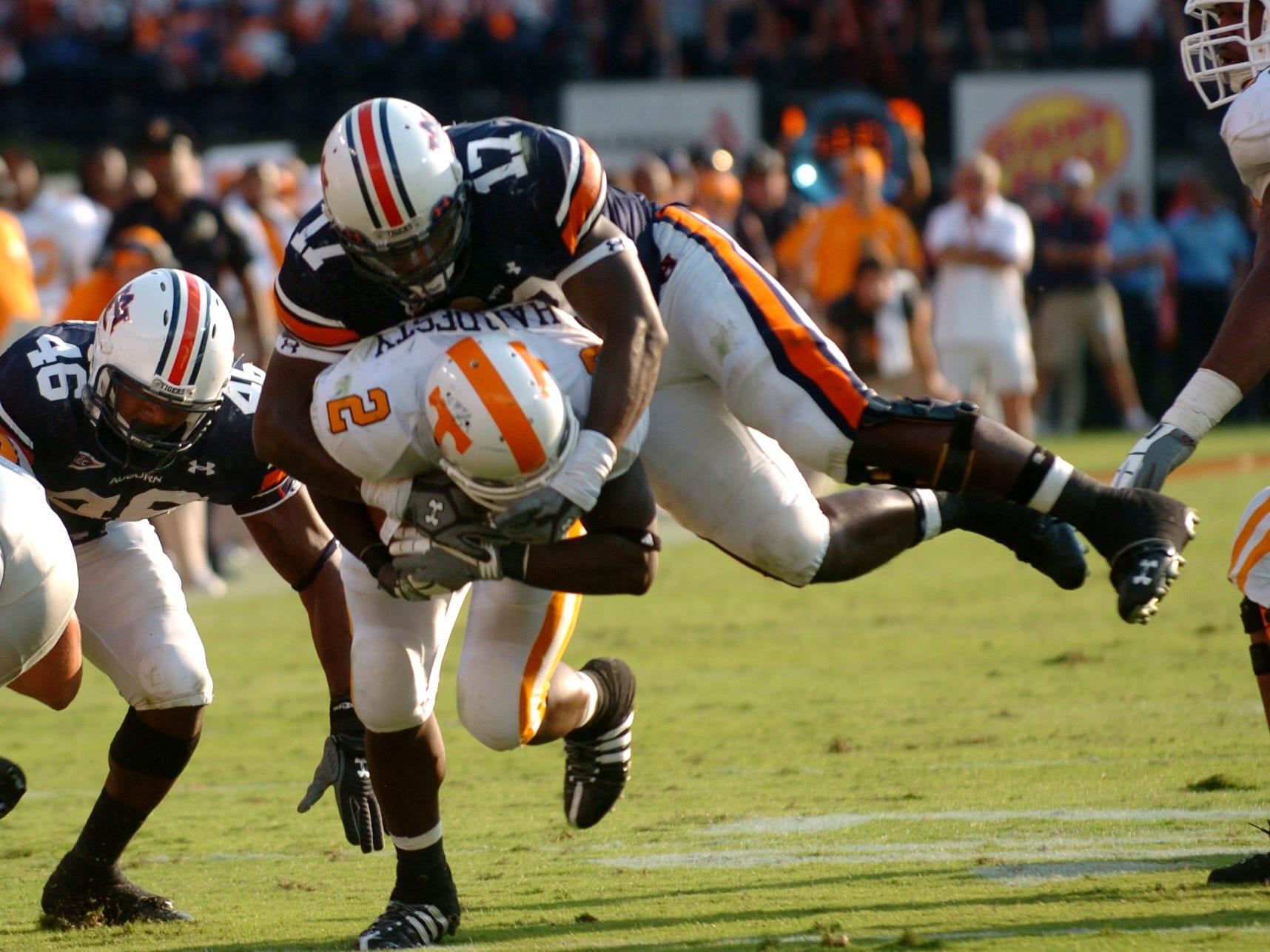 Tennessee running back Montario Hardesty (2) is tackled by Auburn linebacker Joshua Bynes (17) Saturday at Jordan-Hare Stadium in Alabama in 2008. Auburn won 14-12, dropping the Vols' season record to 1-3.