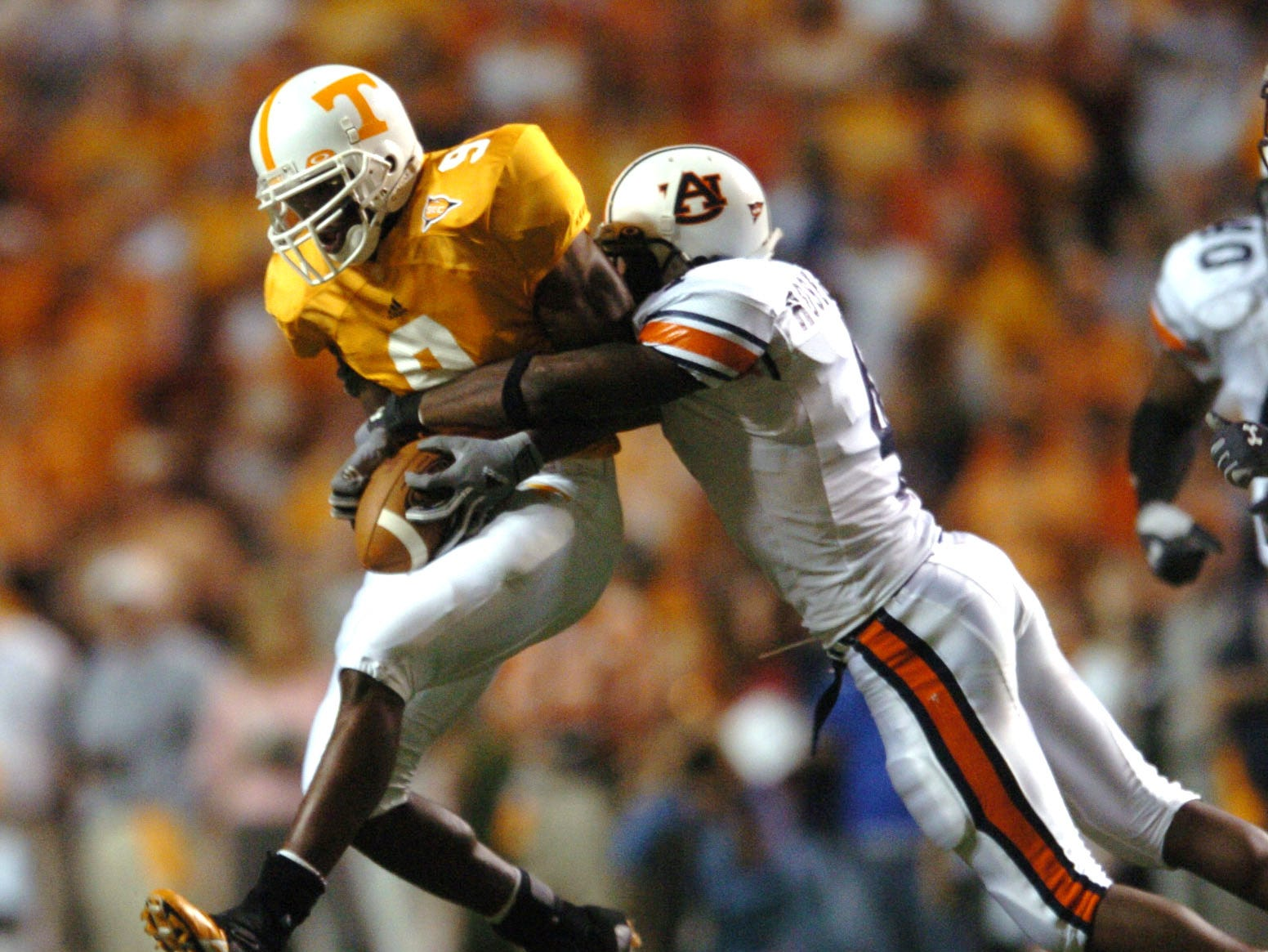 UT's  Bret Smith (9) tries to get away from an Auburn defender in 2004.