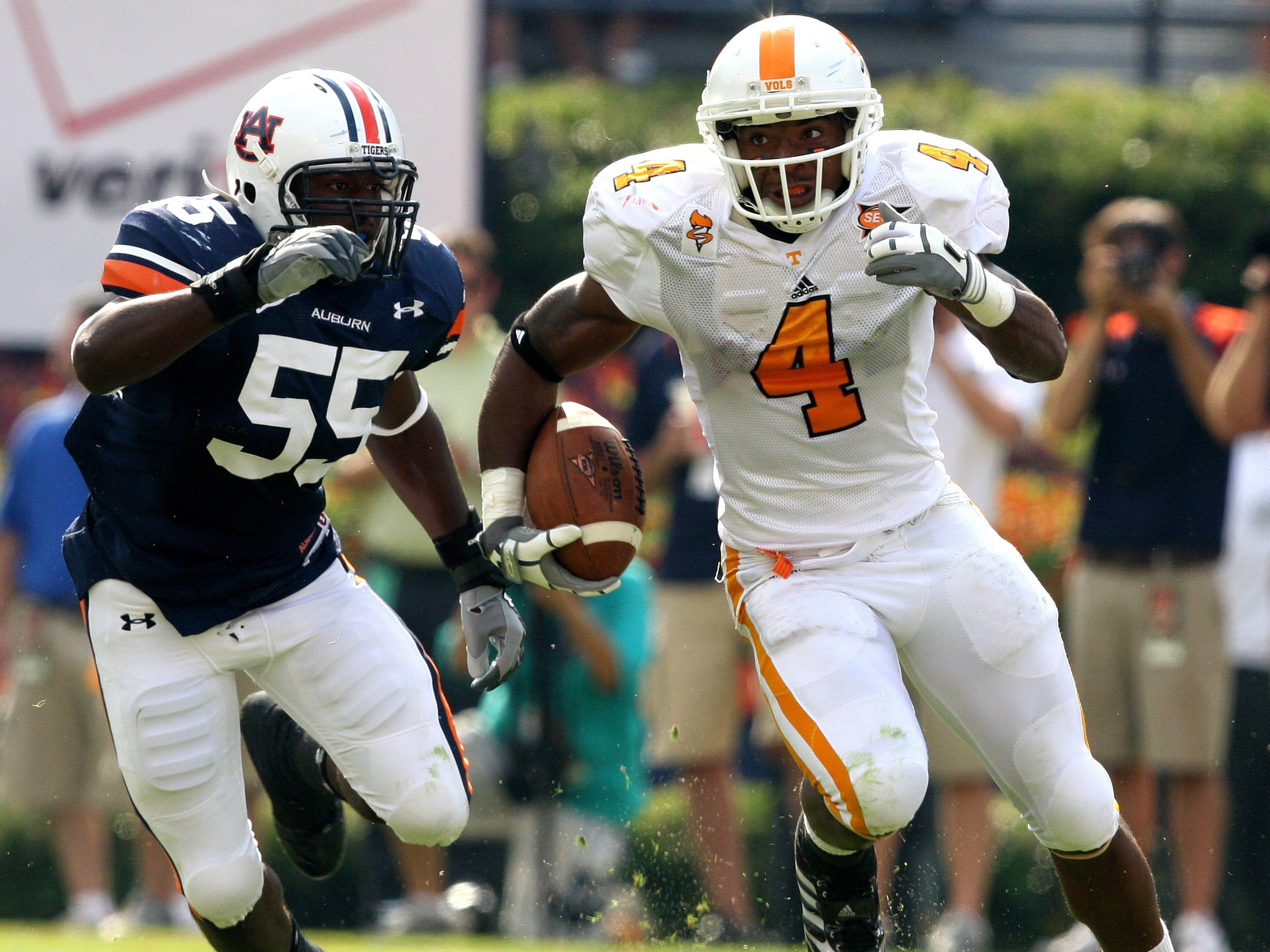 Tennessee wide receiver Gerald Jones (4) runs past Auburn linebacker Merrill Johnson (55) in the first half of an NCAA college football game in Auburn, Ala., Saturday, Sept. 27, 2008.