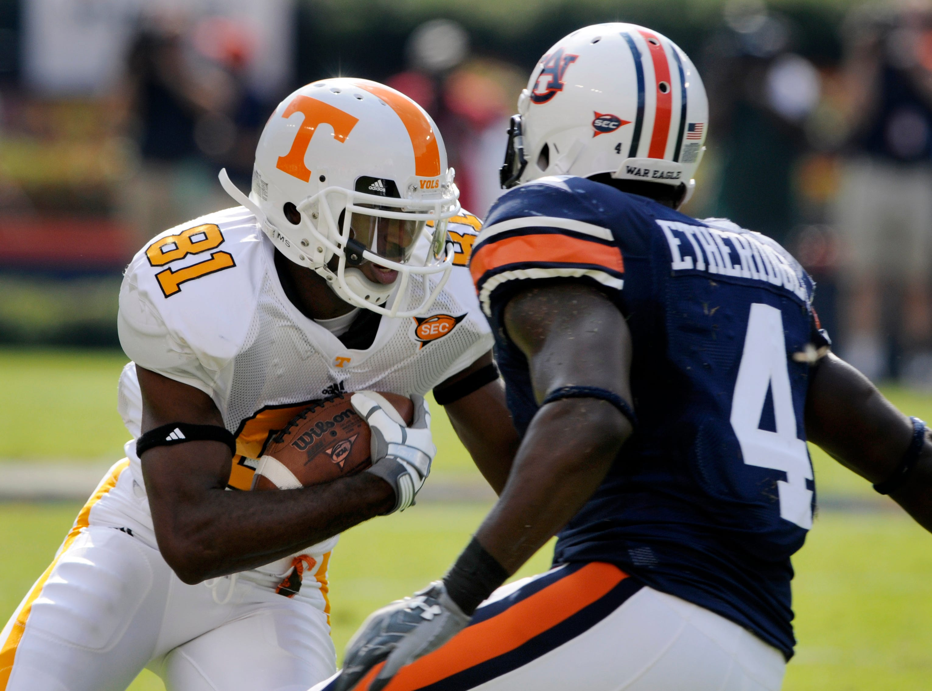Tennessee wide receiver Josh Briscoe (81) tries to get around Auburn defensive back Zac Etheridge (4) Saturday in Jordan-Hare Stadium in Alabama in 2008. Auburn won 14-12, dropping the Vols' season record to 1-3.