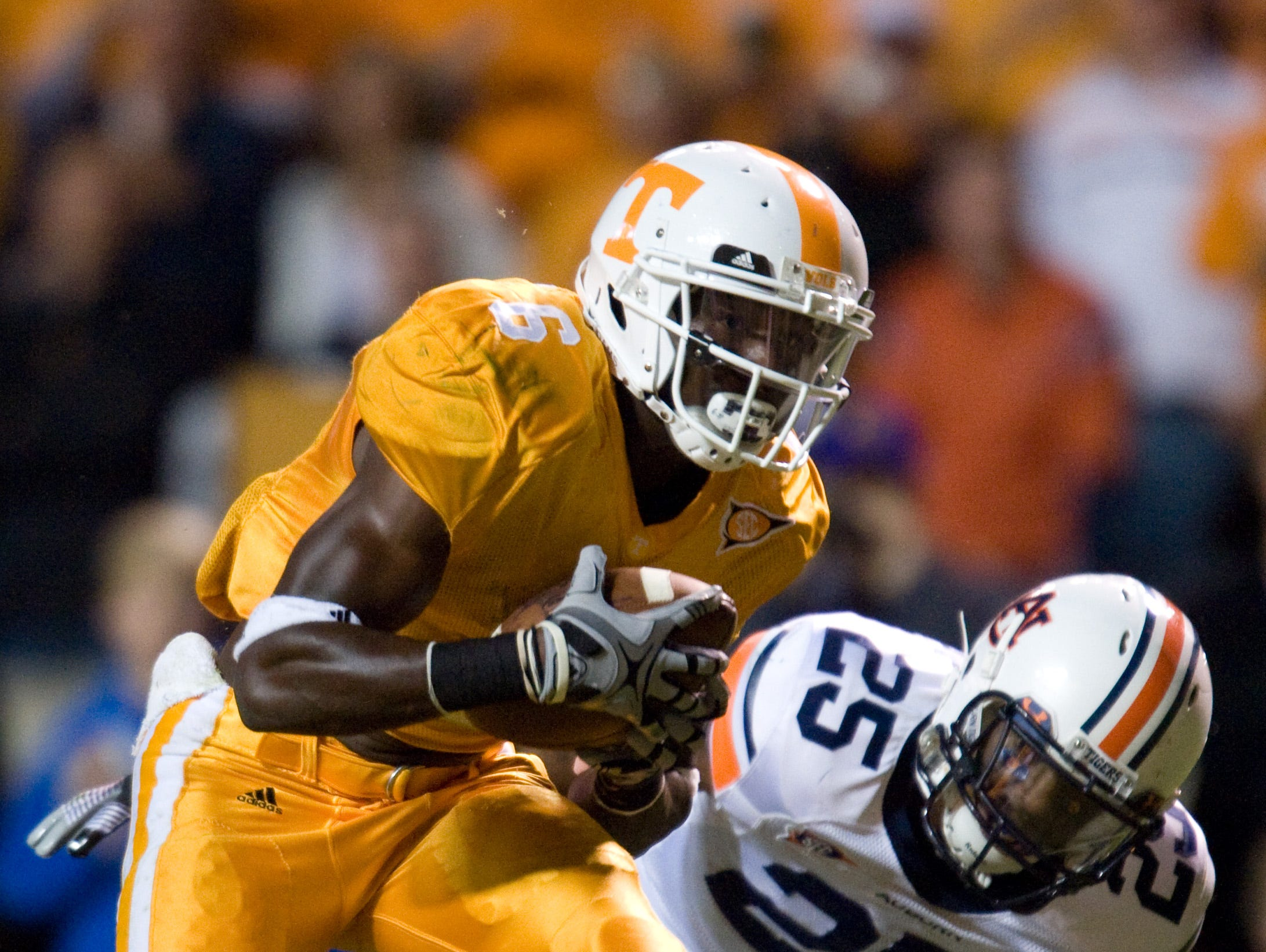 Tennessee wide receiver Denarius Moore (6) catches a pass in front of Auburn cornerback Daren Bates (25)on Saturday, Oct. 3, 2009 at Neyland Stadium.