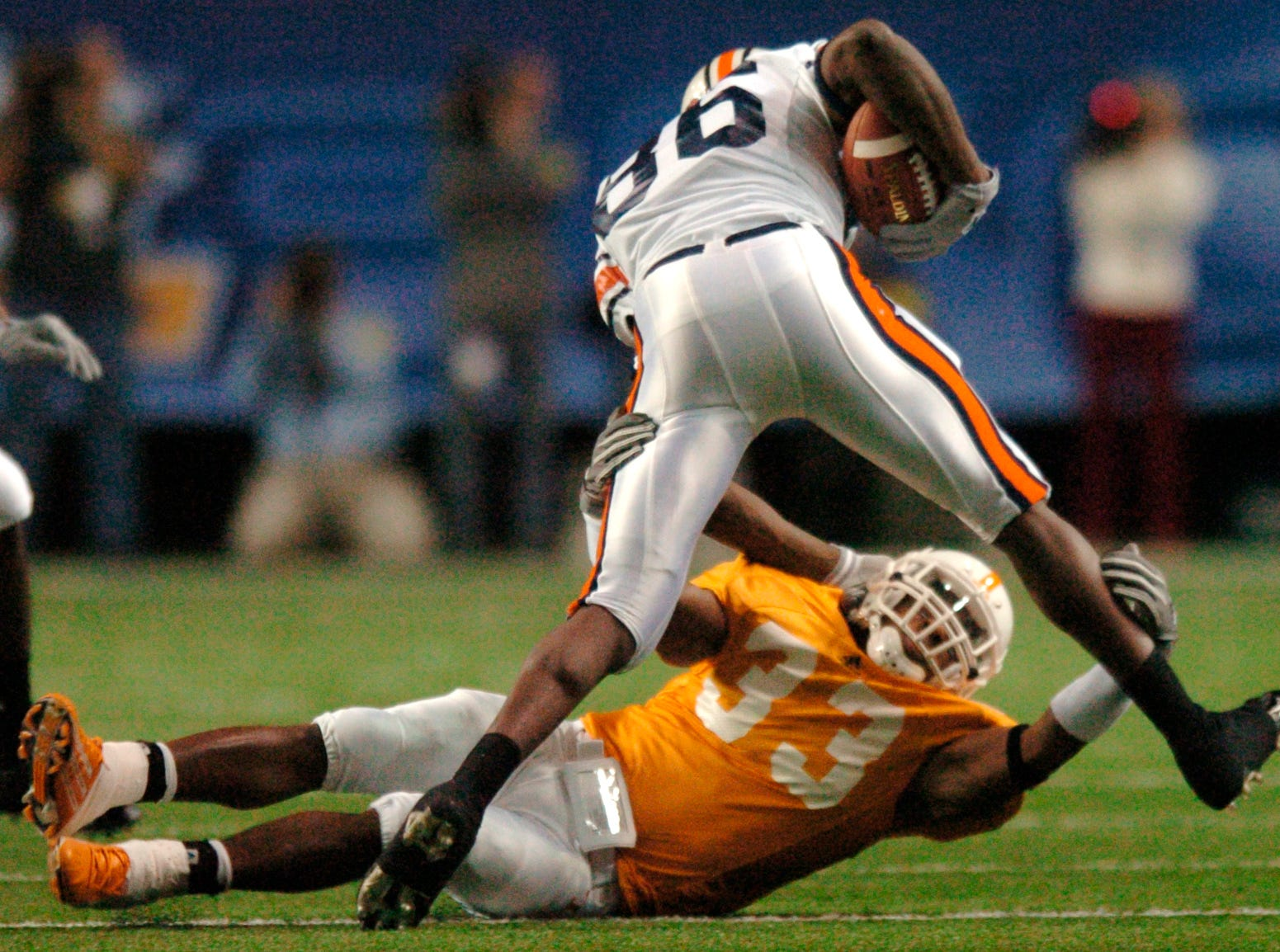 UT's Jonathan Hefney (33) tries to take down Auburn's Courtney Taylor (86) during the SEC Championship Game in the Georgia Dome Saturday night in Atlanta in 2004.