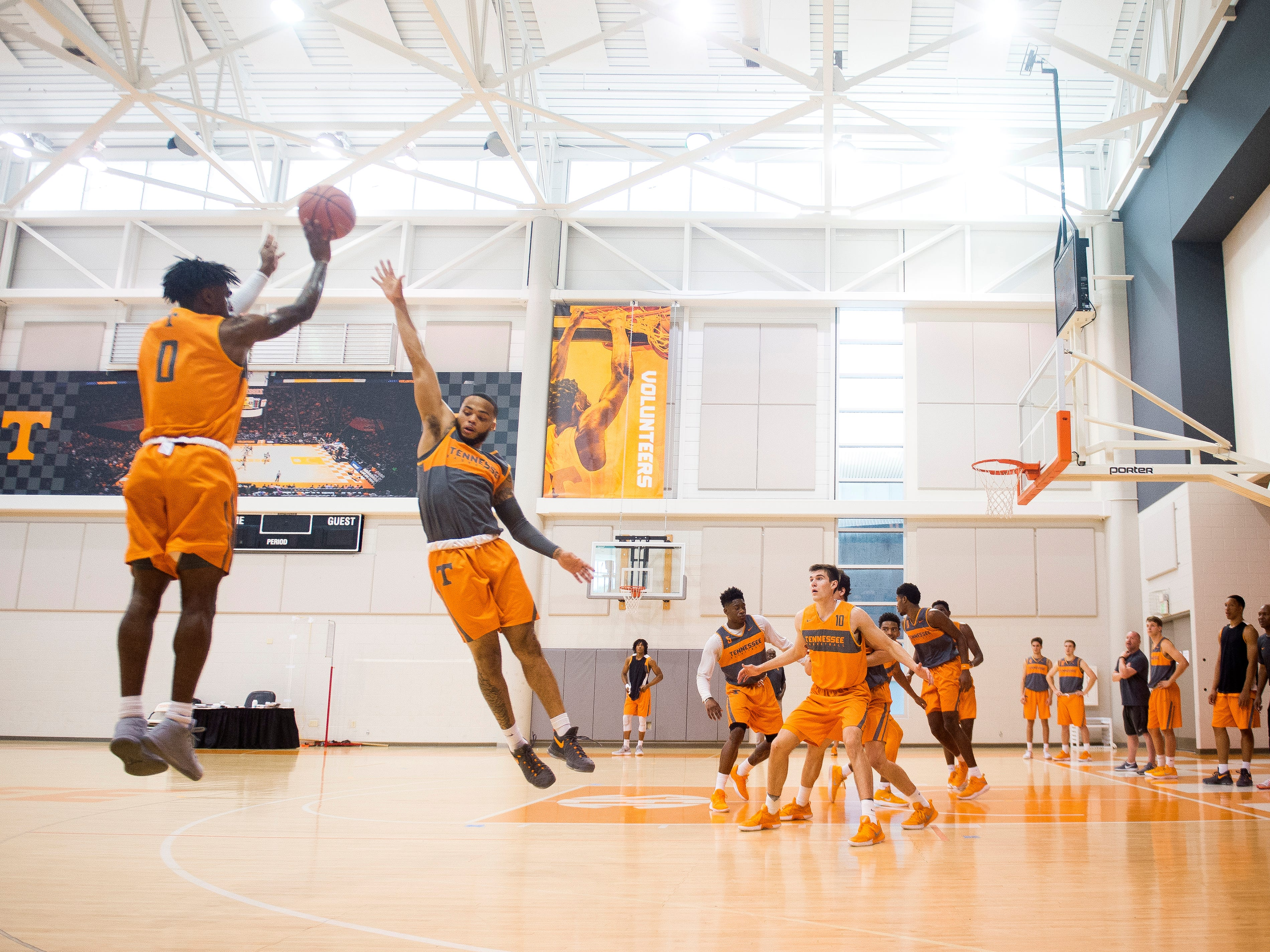 Tennessee guard Jordan Bone (0) shoots past guard Lamonte Turner (1) during basketball practice at Pratt Pavilion on the University of Tennessee's campus on Thursday, October 4, 2018.