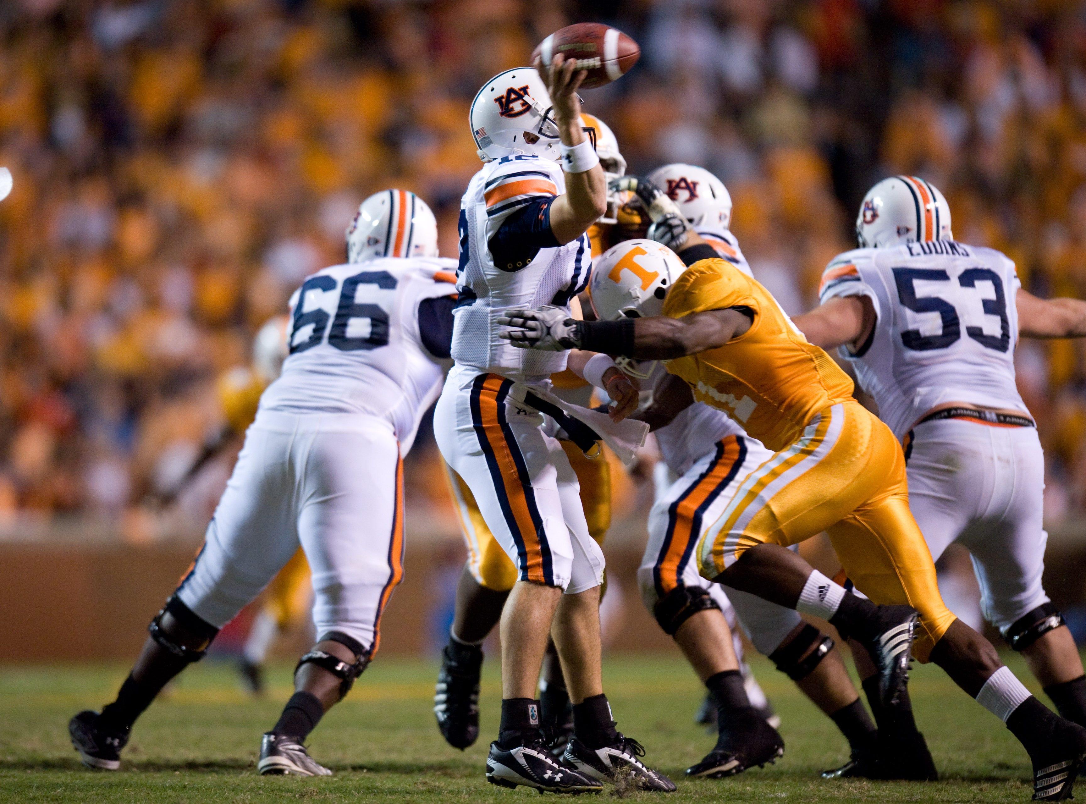 Tennessee cornerback Dennis Rogan (41) hits Auburn quarterback Chris Todd (12) on Saturday, Oct. 3, 2009 at Neyland Stadium.