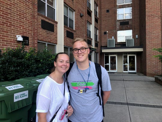 Emma Barnhart, left, and Wylan Feick stand outside Laurel Hall at the University of Tennessee. On Wednesday, students were told they would have to move out of the residence hall in the coming weeks.