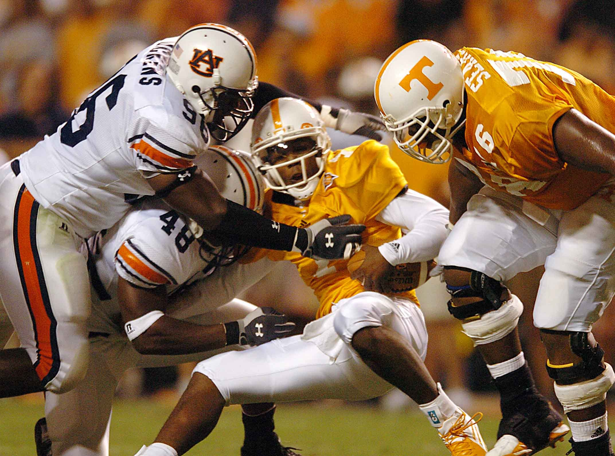 Tennessee quarterback (7) Brent Schaeffer is tackled by Auburn's (48) Marquies Gunn (CQ) and (96) Wayne Dickens during first half action Saturday night in 2004. Tennessee's Arron Sears is at right.