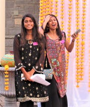FHS students Reva Bagi and Yasha Doddabele volunteered to assist during the party.