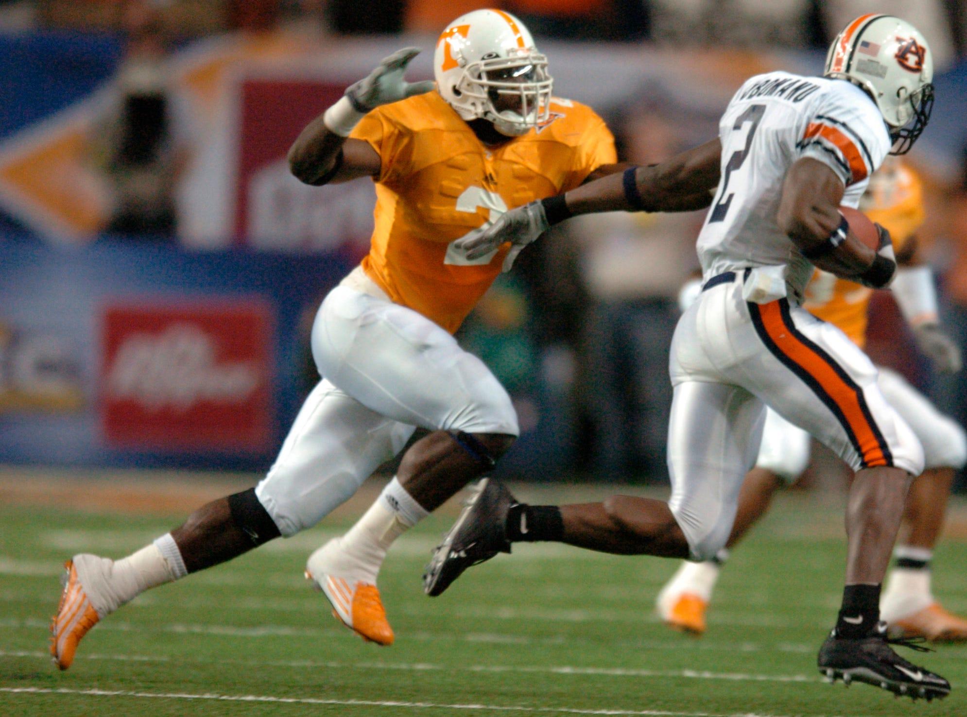 UT's Kevin Burnett (2) chases Auburn's Ben Obomanu (2) during the SEC Championship Game in the Georgia Dome Saturday night in Atlanta in 2004.