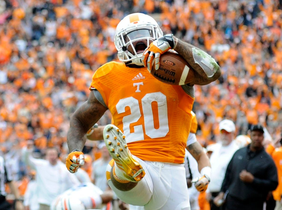 Tennessee running back Rajion Neal (20) scores a touchdown during the first half against Auburn at Neyland Stadium in Knoxville on Saturday, Nov. 9, 2013.