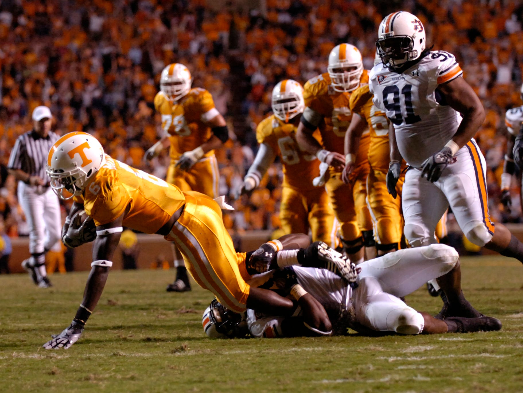 Tennessee wide receiver Denarius Moore (6) is tripped up as he carries the ball against Auburn on Saturday, October 3rd, 2009 at Neyland Stadium. Tennessee lost the game 26-22.