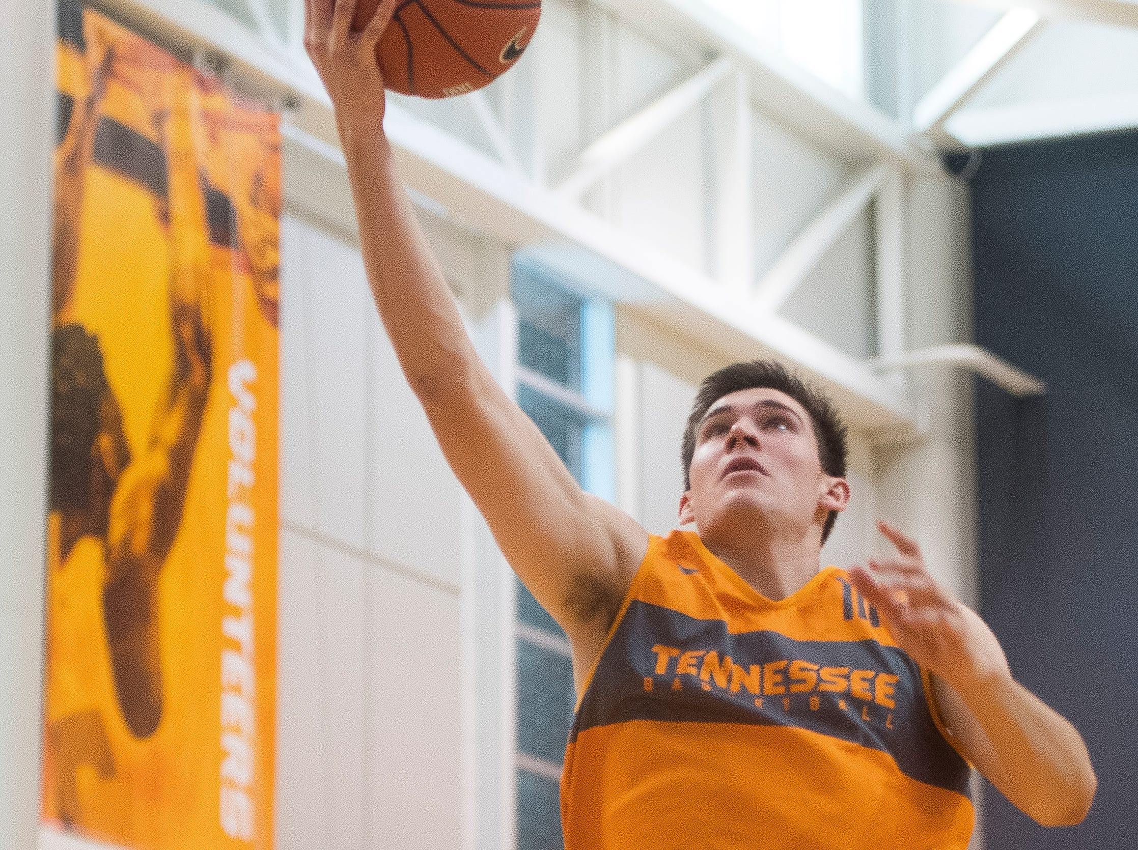 Tennessee forward John Fulkerson (10) goes for a layup during basketball practice at Pratt Pavilion on the University of Tennessee's campus on Thursday, October 4, 2018.