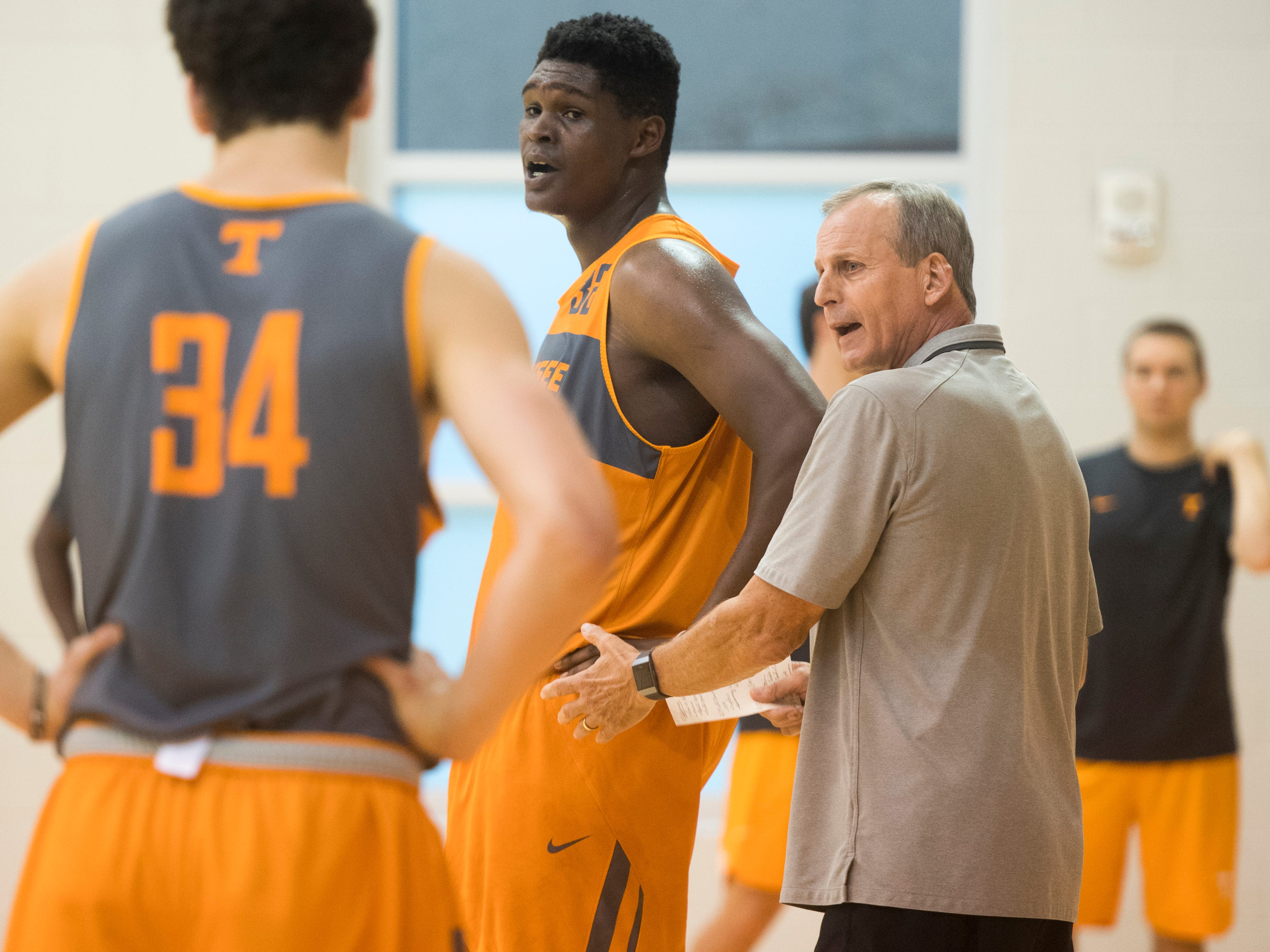 Tennessee head coach Rick Barnes speaks to his players during basketball practice at Pratt Pavilion on the University of Tennessee's campus on Thursday, October 4, 2018.