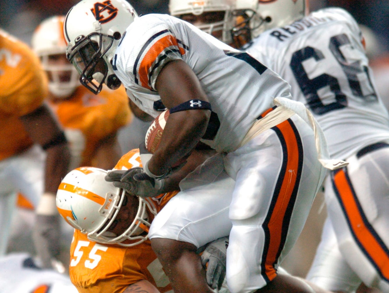 Tennessee defensive tackle Jesse Mahelona takes down Auburn running back Ronnie Brown (23) in the third quarter during the Southeastern Conference championship game Saturday in Atlanta in 2004