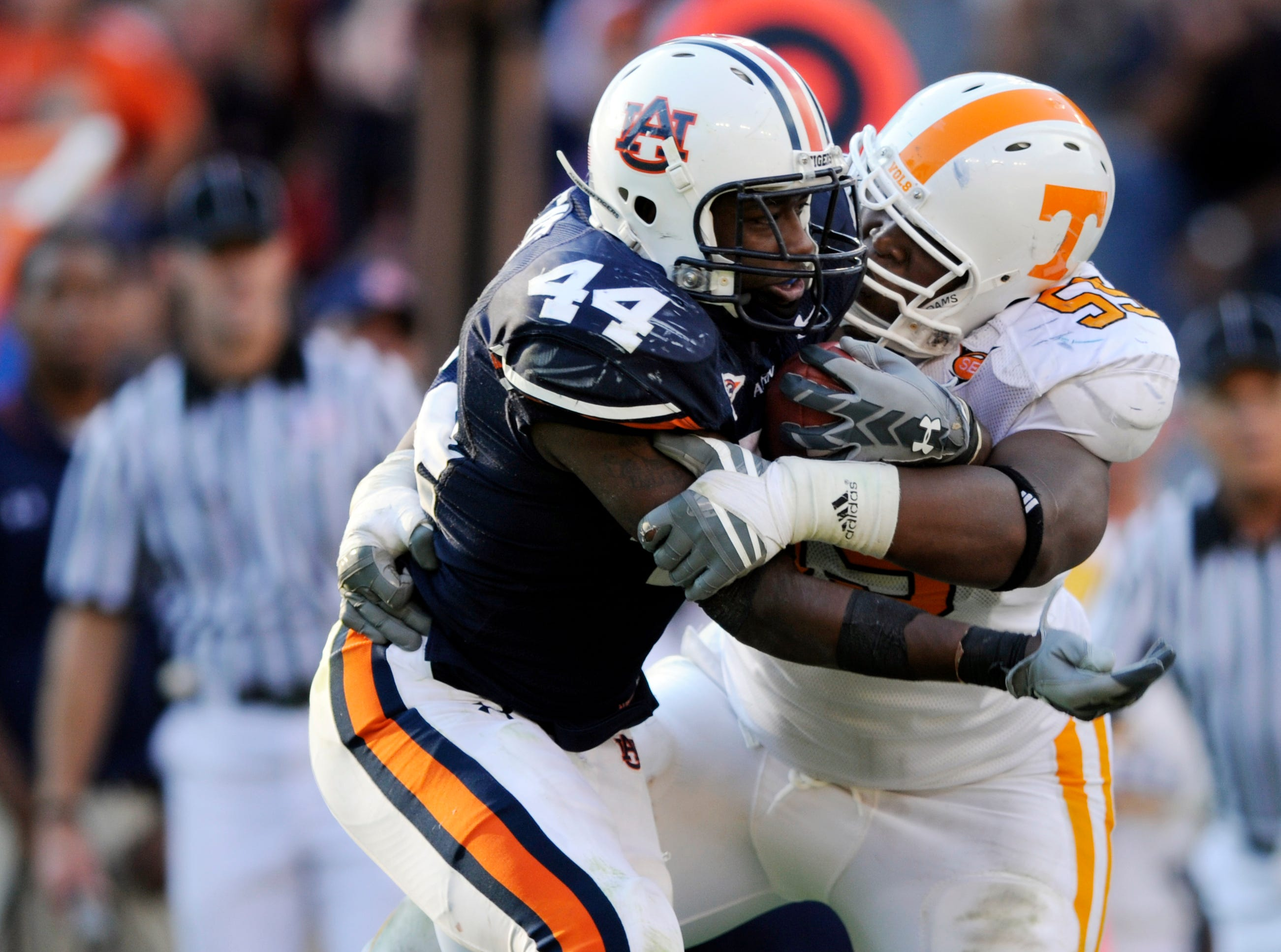 Tennessee defensive tackle Dan Williams (55) stops Auburn running back Ben Tate (44) Saturday at Jordan-Hare Stadium in Alabama in 2008. Auburn won the game 14-12, dropping Tennessee to 1-3 for the season.