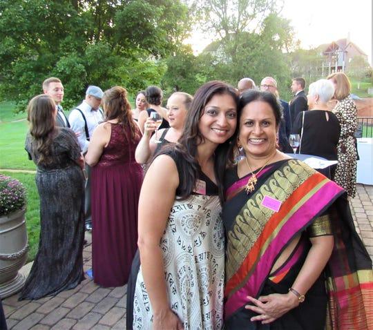 Smita Borole relied on longtime friend Vijaya Perumalla to lend a hand greeting guests.