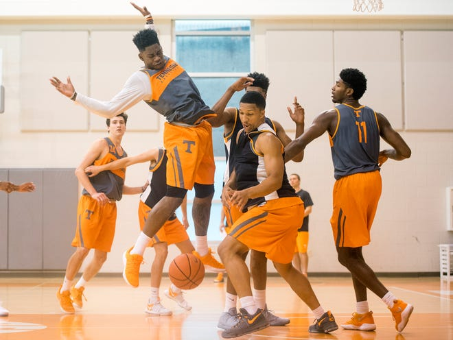 Tennessee forward Grant Williams (2) goes after a loose ball during practice Thursday at Pratt Pavilion.