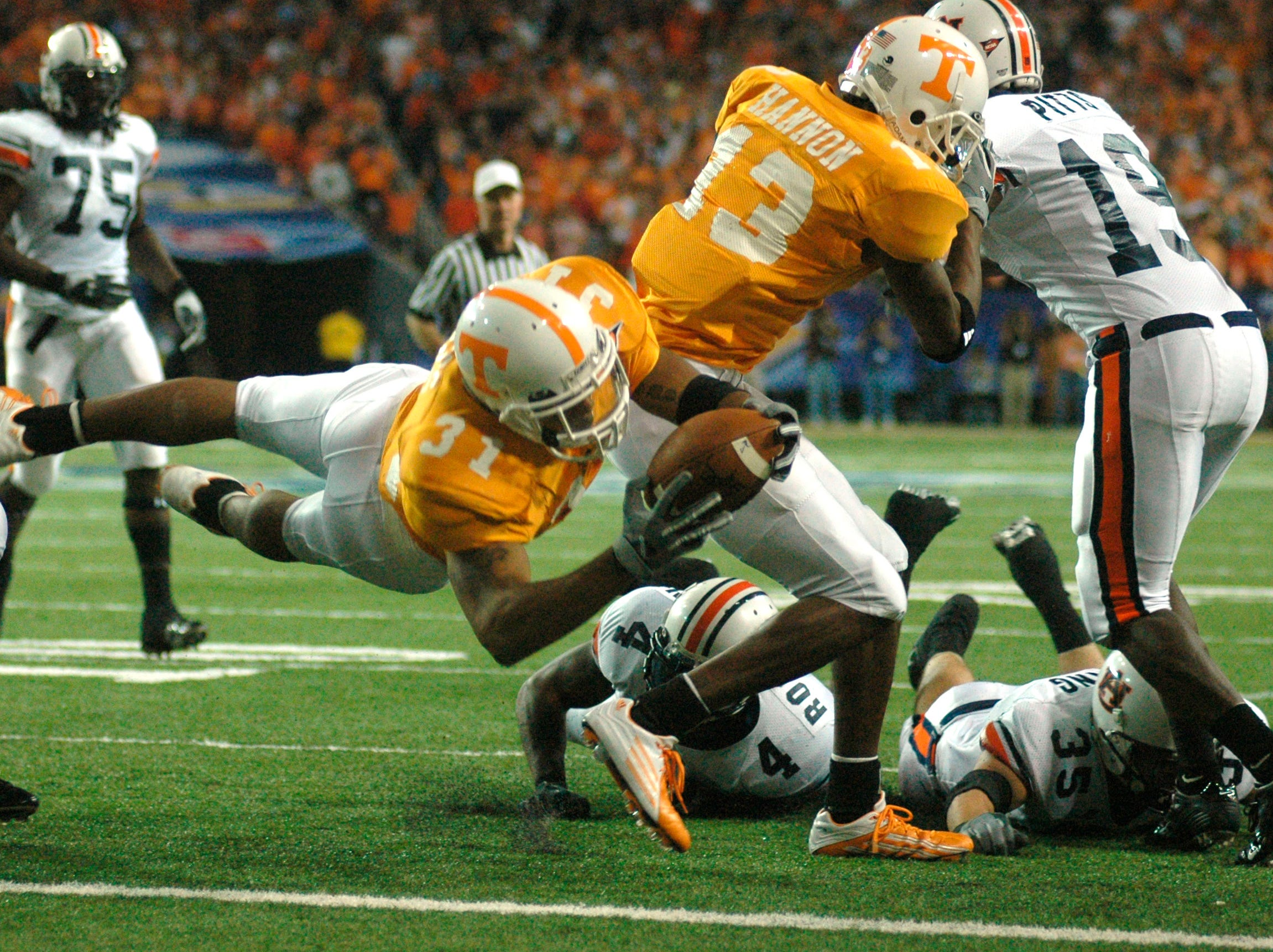Tennessee running back Gerald Riggs (31) flies into the end zone for a touchdown against Auburn during the Southeastern Conference championship game Saturday in Atlanta in 2004. Riggs rushed for 182 yards and two TDs in a losing effort against Auburn.
