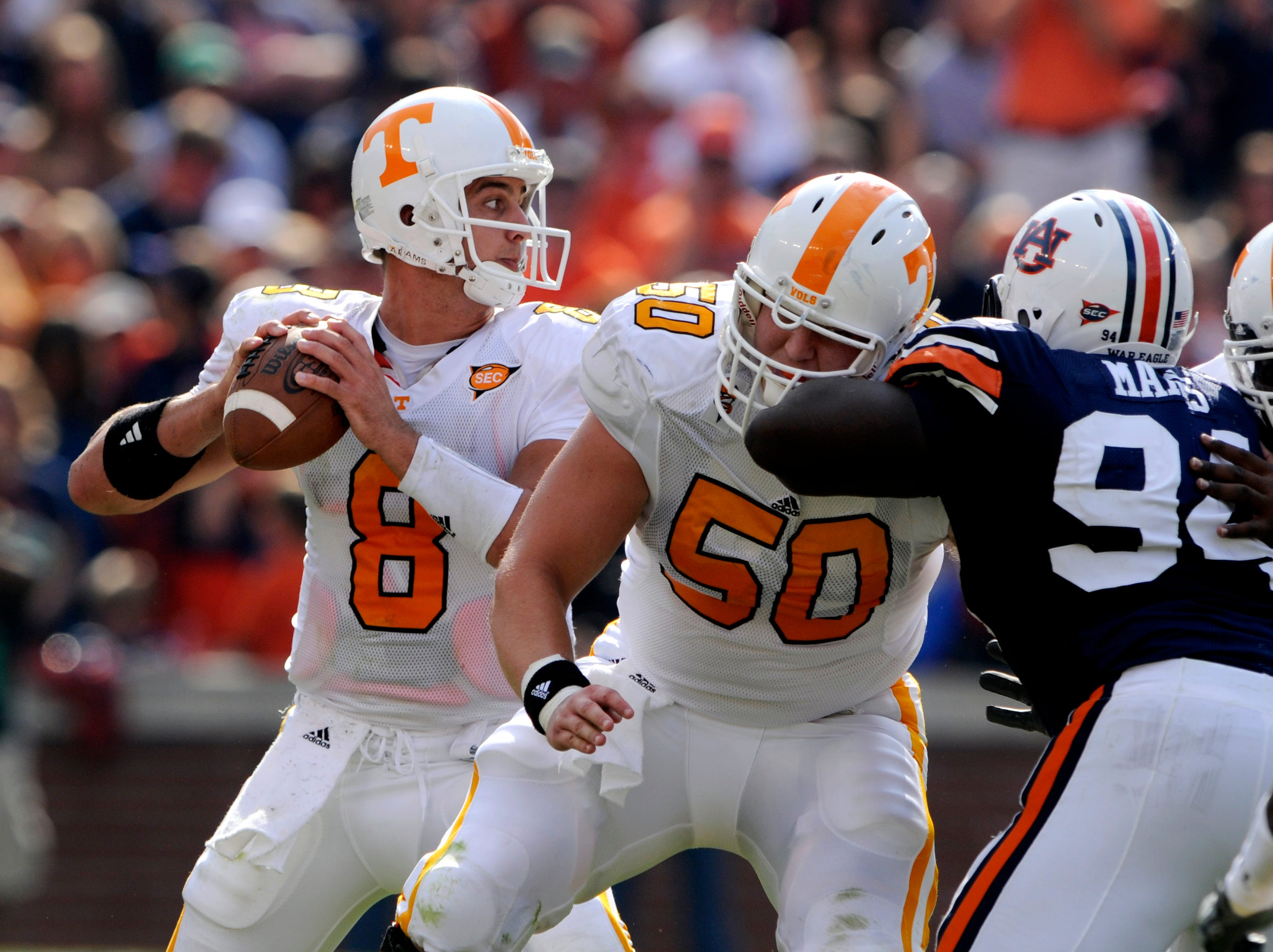 Tennessee center Josh McNeil (50) protects quarterback Jonathan Crompton (8) against Auburn Saturday at Jordan-Hare Stadium in Alabama in 2008. Auburn won  14-12, dropping Tennessee to 1-3 for the season.