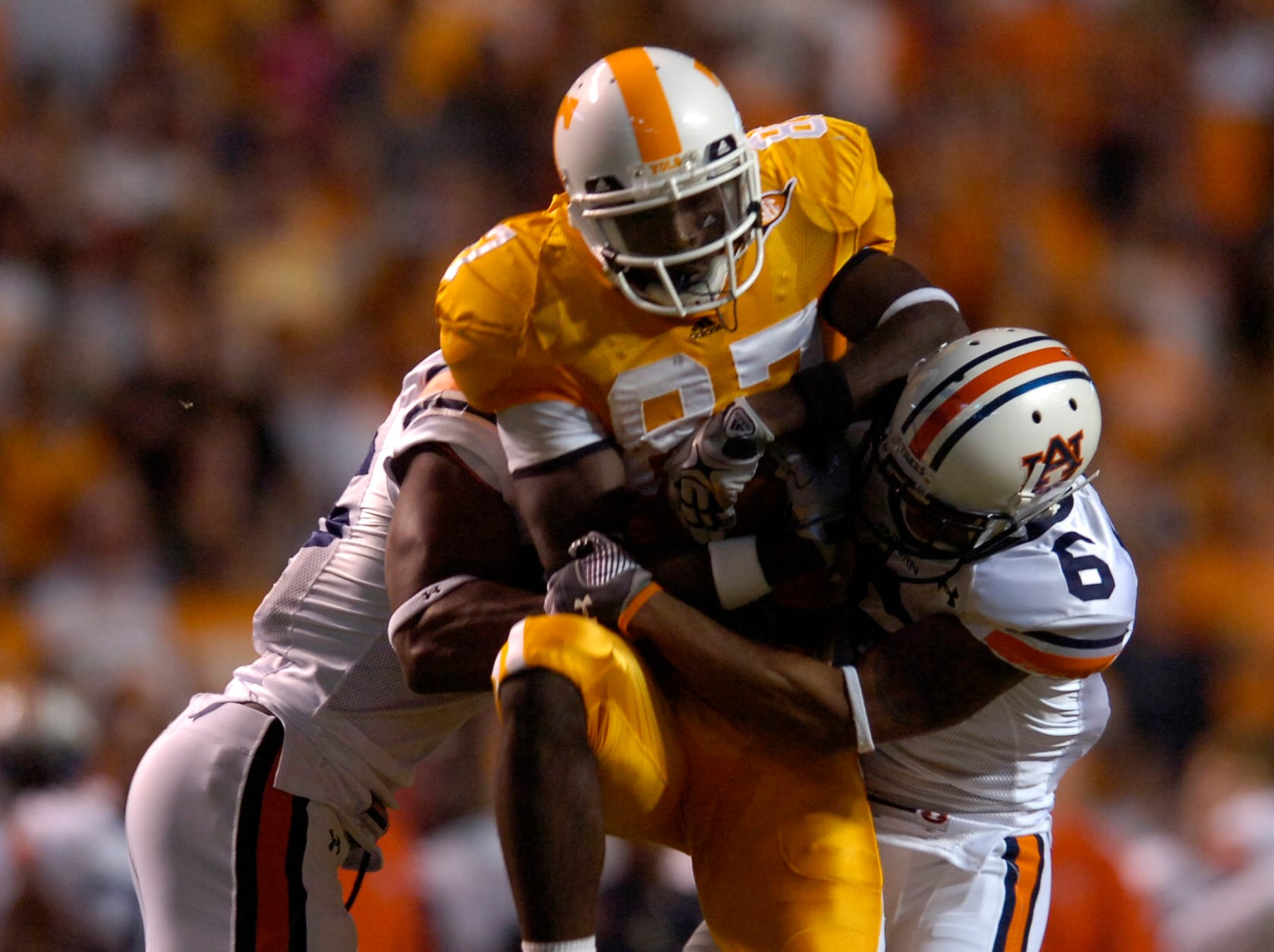 Tennessee wide receiver Quintin Hancock (87) is stopped by Auburn defenders on Saturday, October 3rd, 2009 at Neyland Stadium. Tennessee lost the game 26-22.